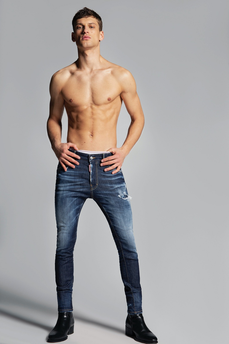 Front and center, David Trulik wears Dsquared2's dark wash Super Twinky jeans.