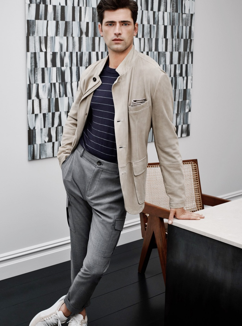 Sean O'Pry sports a striped wool sweater, stretch wool cargo pants, and sneakers from Eleventy.