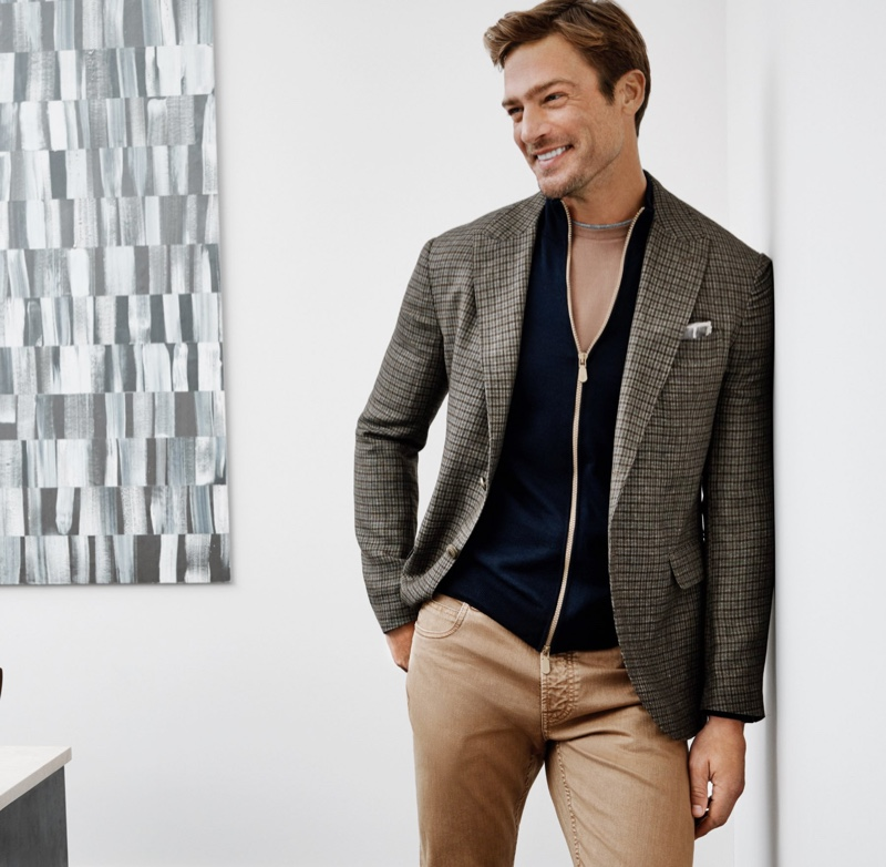 Going smart-casual, Jason Morgan models a linen-wool blend sport coat with a merino-blend sweater and washed cotton jeans by Eleventy.