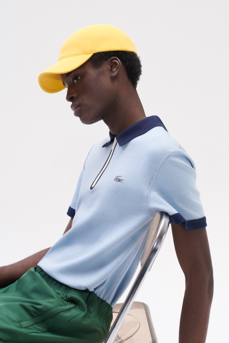 Babacar N'doye models a sky blue polo shirt from Lacoste's fall-winter 2020 collection.