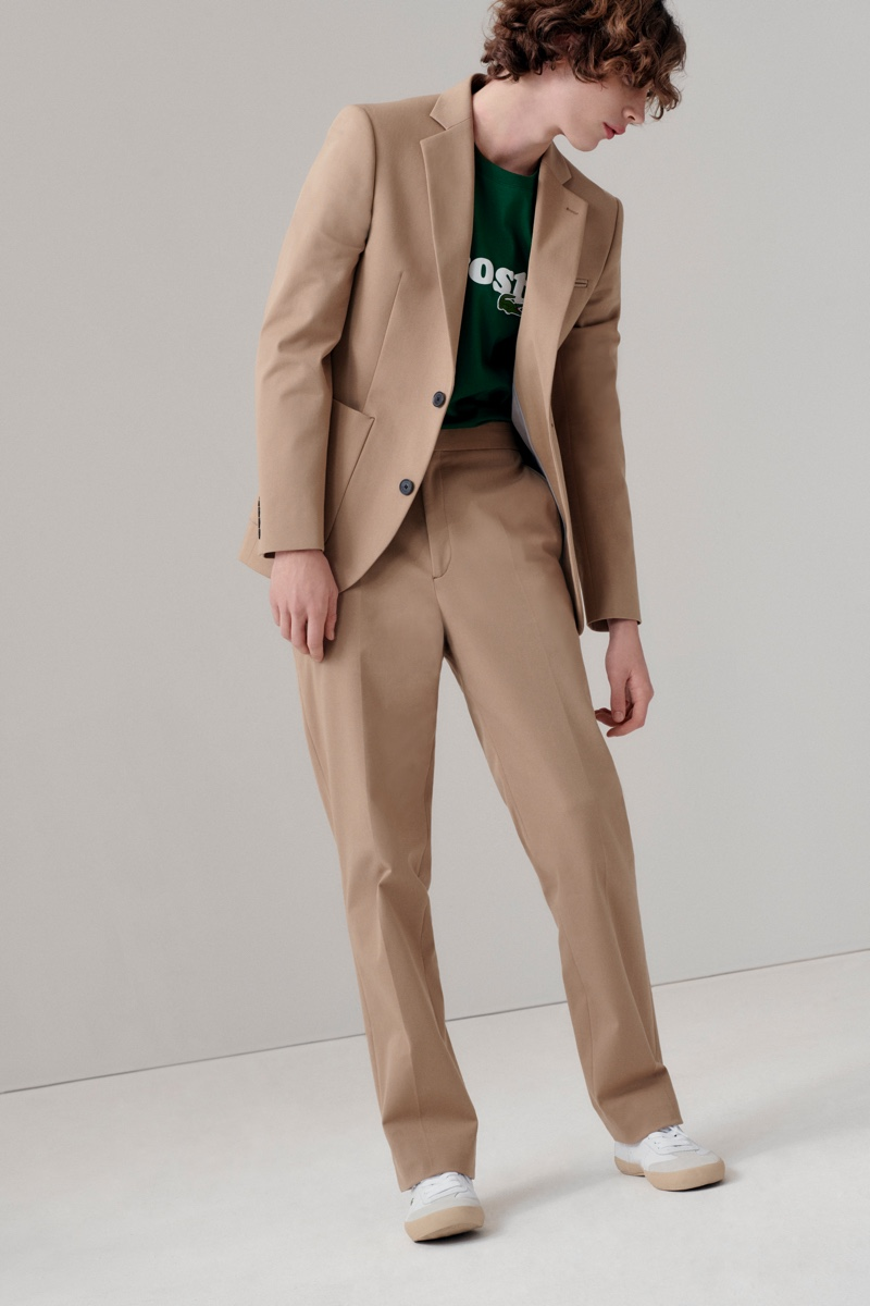 Connecting with Lacoste for fall-winter 2020, Freek Iven wears a khaki suit with a logo tee.