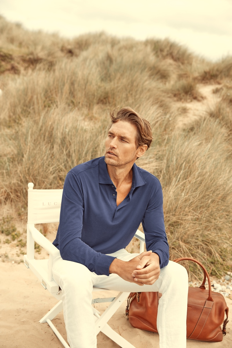 Robertas Aukstuolis sports an ocean blue silk-cotton polo shirt from Luca Faloni for the brand's high summer 2020 campaign.