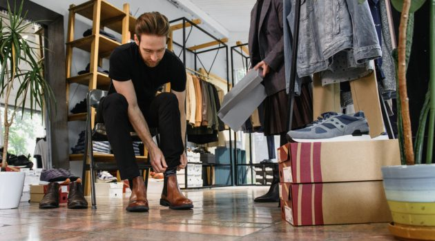Man Trying on Shoes at Store