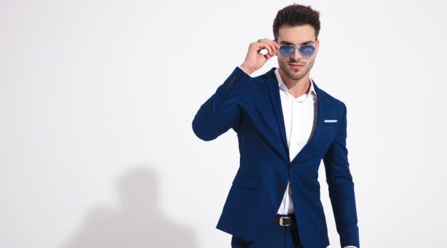 Man in Blue Suit and Sunglasses and Rings
