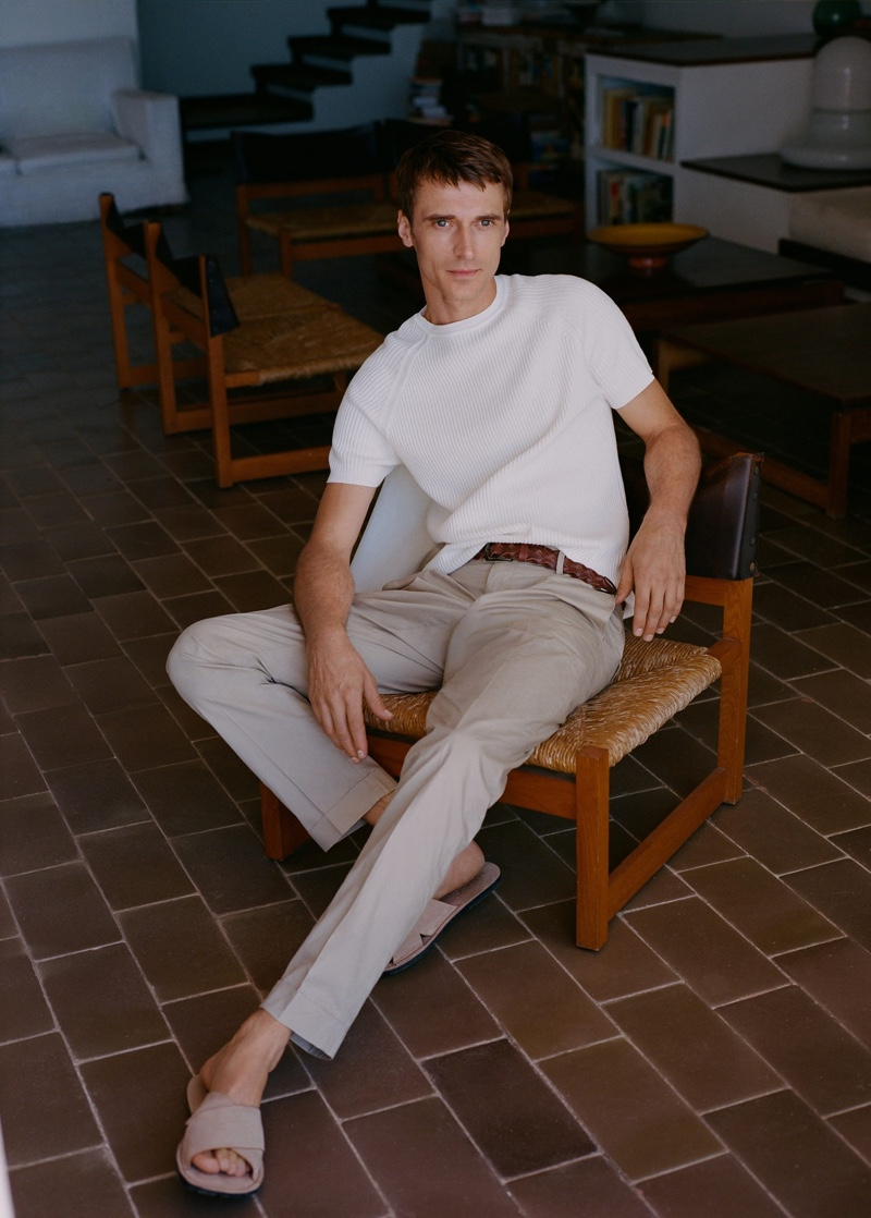 Front and center, Clément Chabernaud models Mango's slim-fit cotton pants with a short-sleeve sweater.