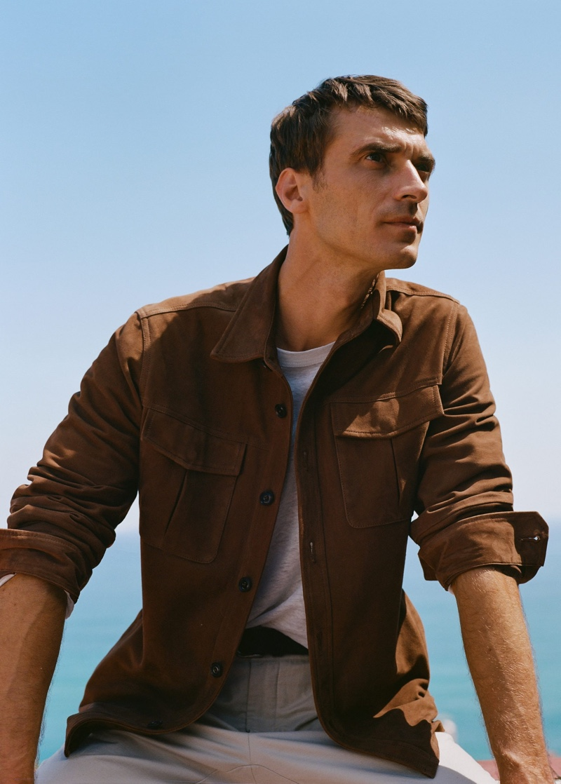 Clément Chabernaud dons a suede effect jacket from Mango.