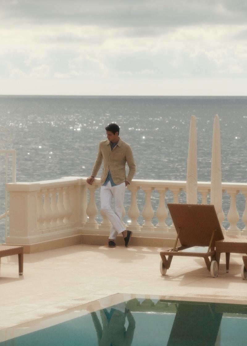 Chic style reigns as Mattia Regonaschi dons a Massimo Dutti linen blazer with a denim shirt, slim-fit chinos, and espadrilles.