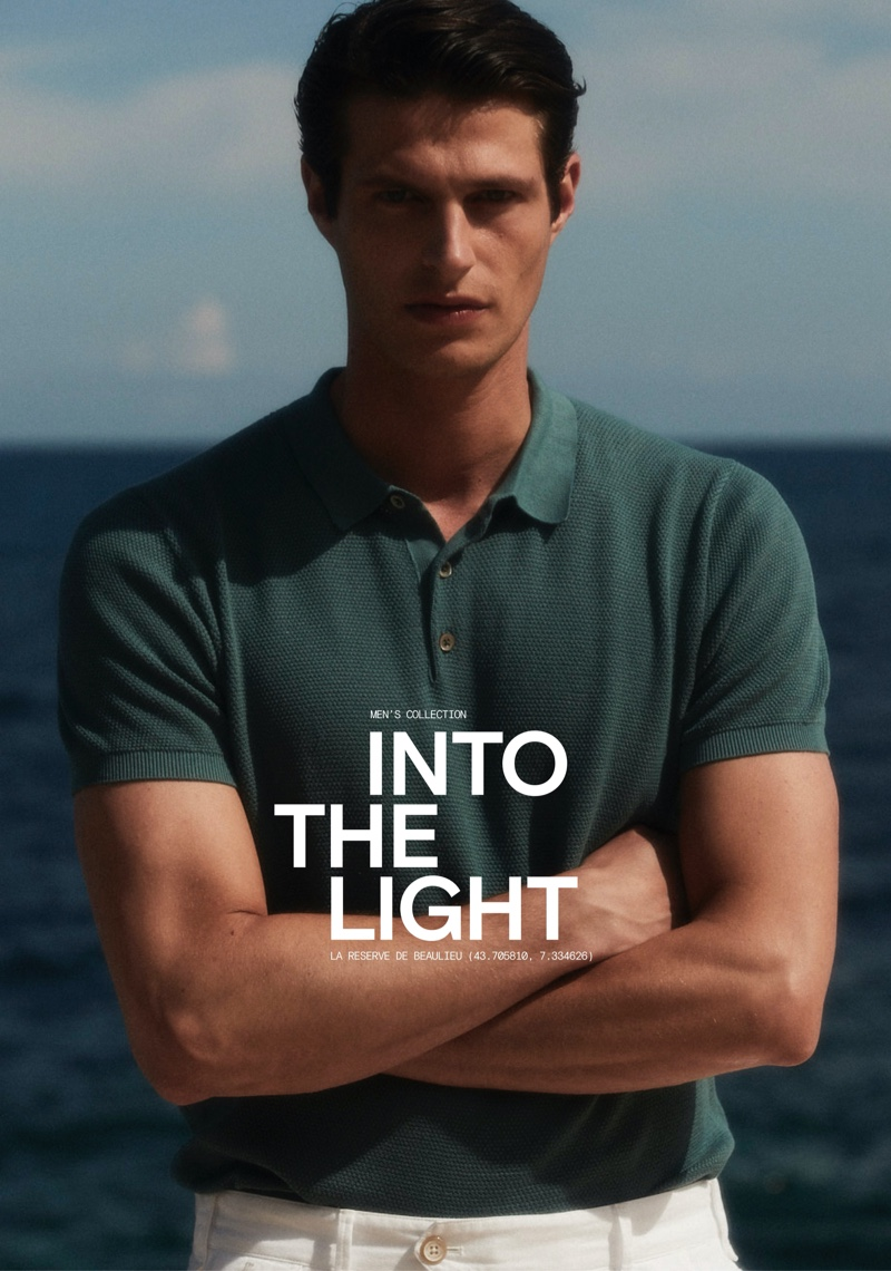 Front and center, Mattia Regonaschi models a short-sleeve Massimo Dutti polo sweater with Bermuda shorts.