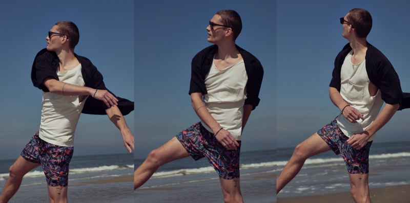 Taking to the beach, William Los sports swim shorts and more from Pull & Bear.