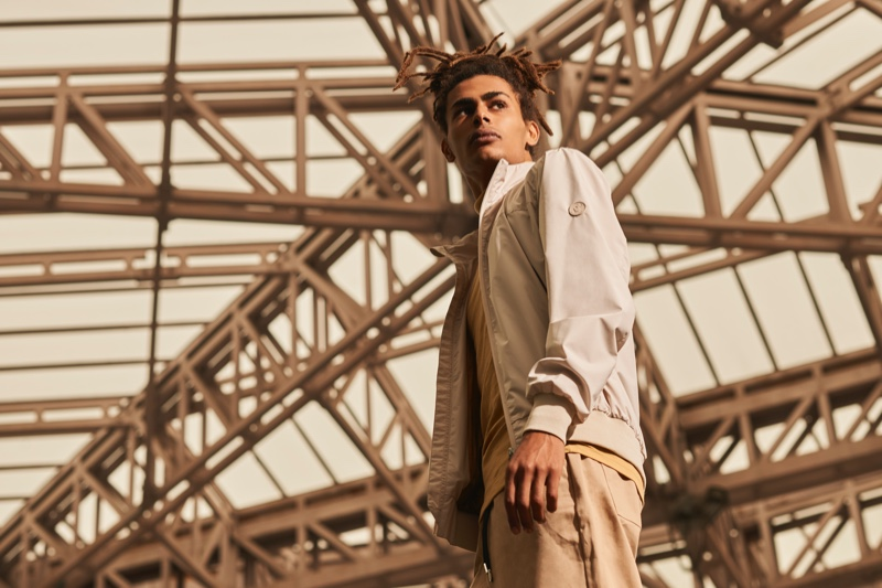 Posing against an urban setting, model Mohamed Ben Salem sports a jacket from Save The Duck.