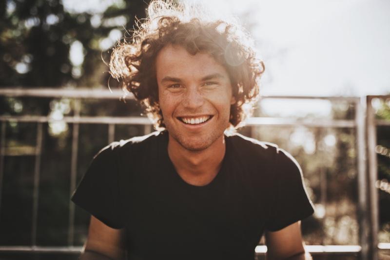 Smiling Man Curly Hair