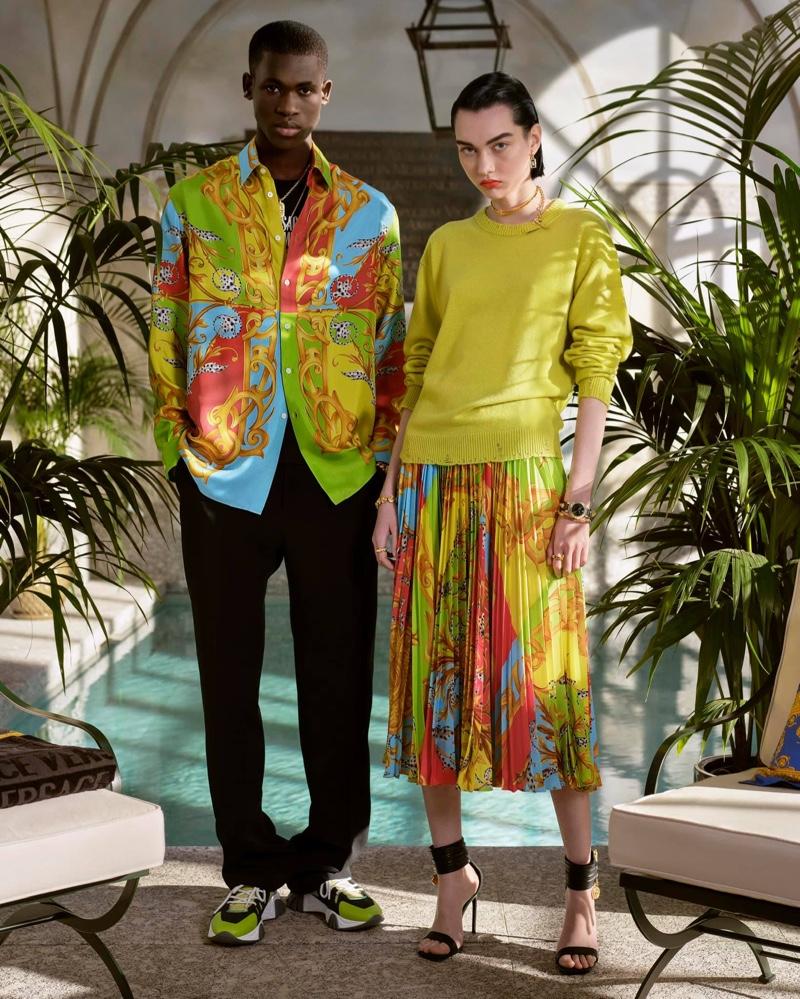 Making a colorful statement, Ismael Savane models Versace's Barocco Acanthus print silk shirt.