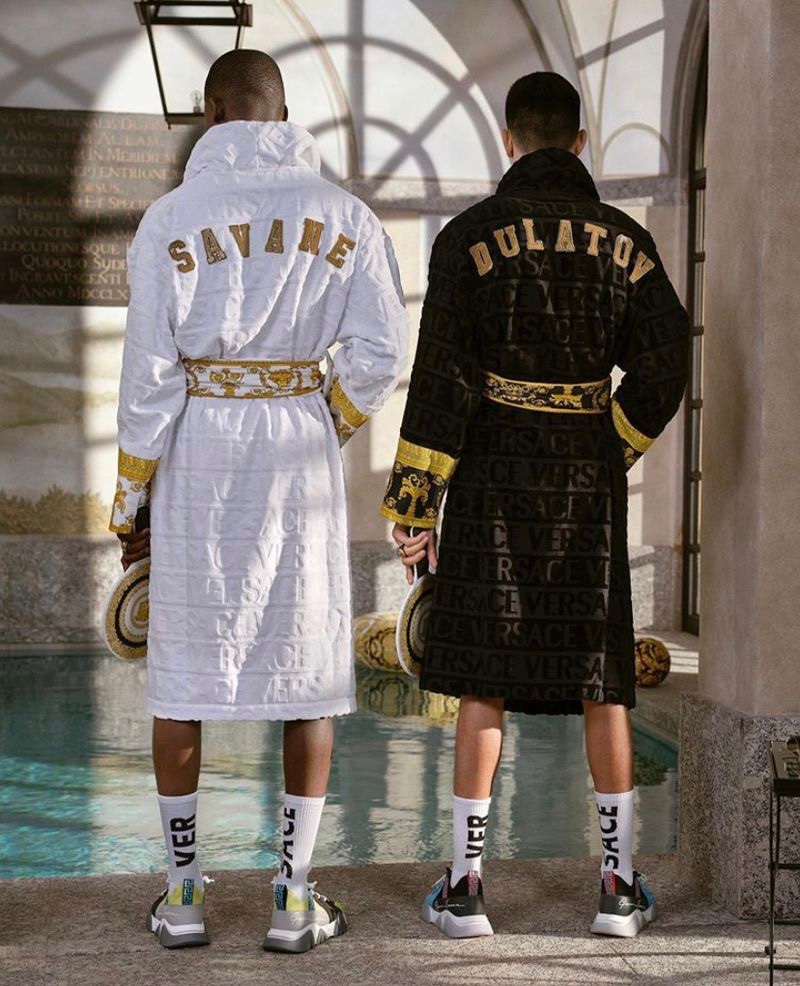 Sporting custom Versace robes, Ismael Savane and Islam Dulatovconnect with the Italian fashion house to model its summer capsule collection.