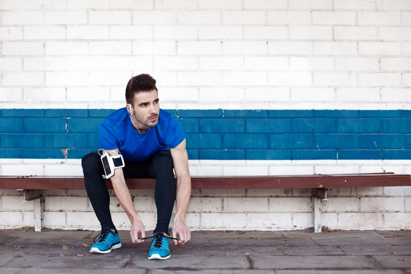 Attractive Man Tying Blue Sneakers Athlete Workout