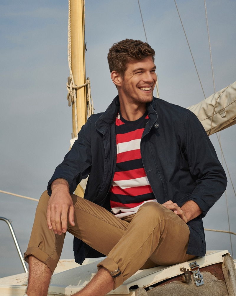Embracing nautical style, Bertold Zahoran wears a striped t-shirt, casual jacket, and chinos from Barbour.