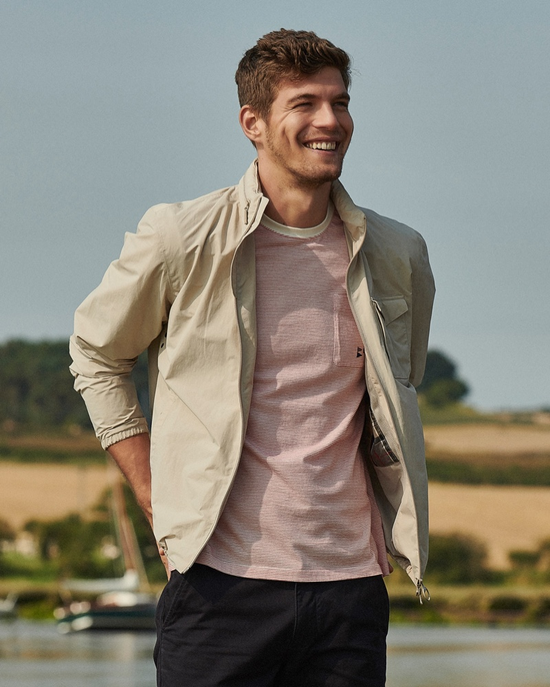 All smiles, Bertold Zahoran sports a waterproof jacket and striped pocket t-shirt by Barbour.All smiles, Bertold Zahoran sports a waterproof jacket and striped pocket t-shirt by Barbour.
