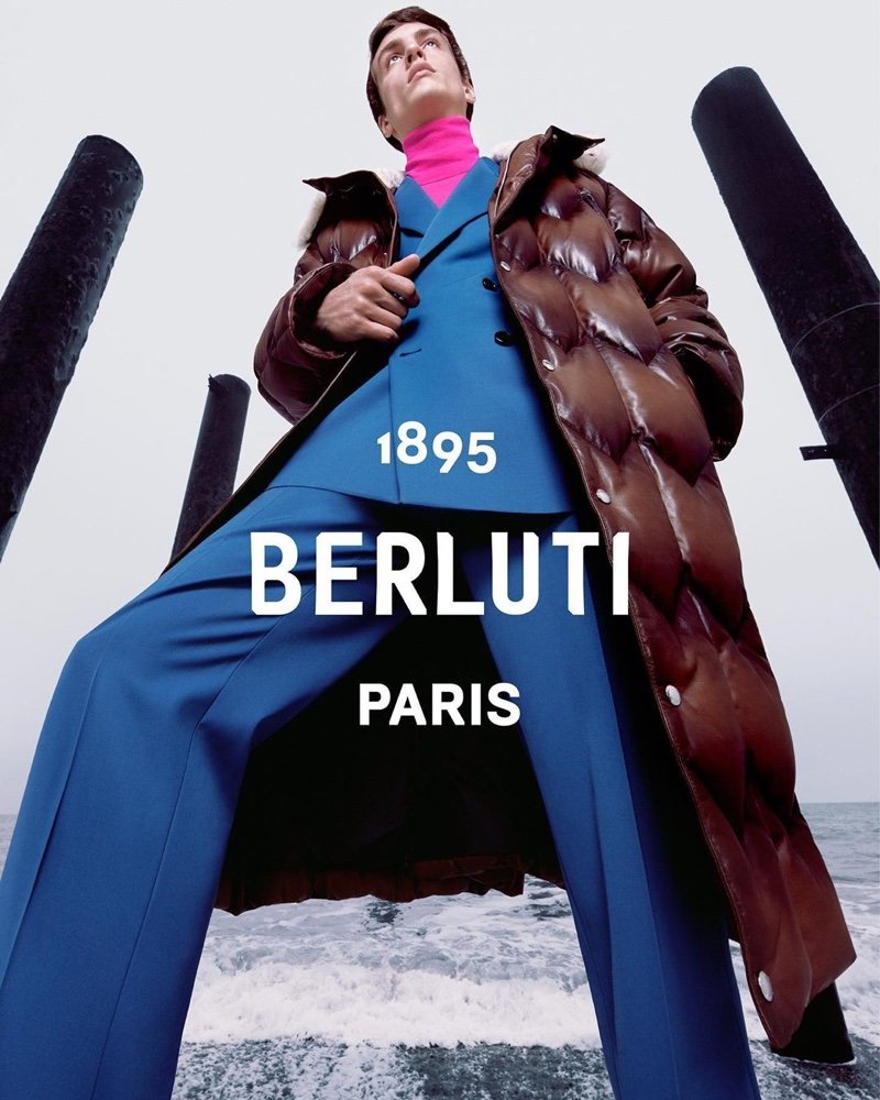 Tobias Dionisi models a double-breasted blue suit with a puffer jacket for Berluti's fall-winter 2020 campaign.