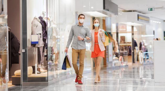 Couple Shopping at Mall with Masks