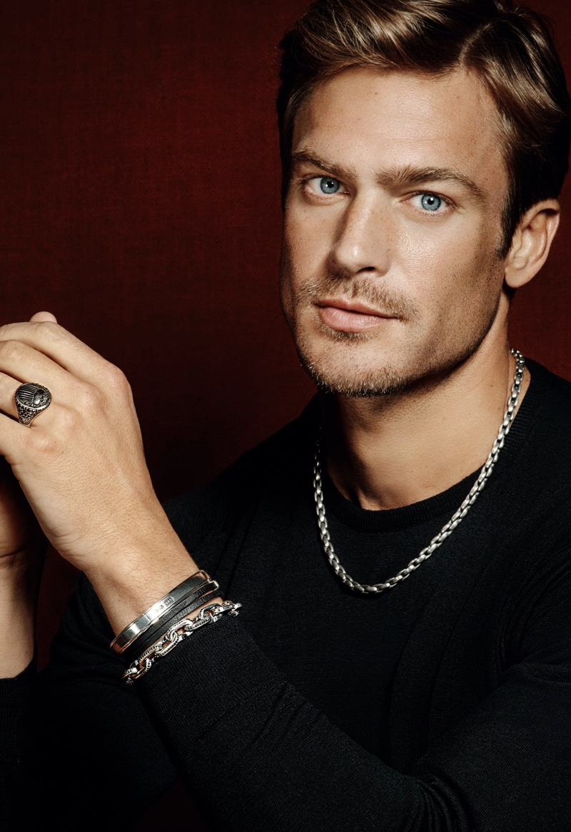 Jason Morgan wears an elongated box chain silver necklace with a streamline chain link silver bracelet from David Yurman. Connecting with Holt Renfrew for the season, he also sports David Yurman's streamline double-wrap leather bracelet and silver bracelet with a Petrvs scarab silver signet ring.