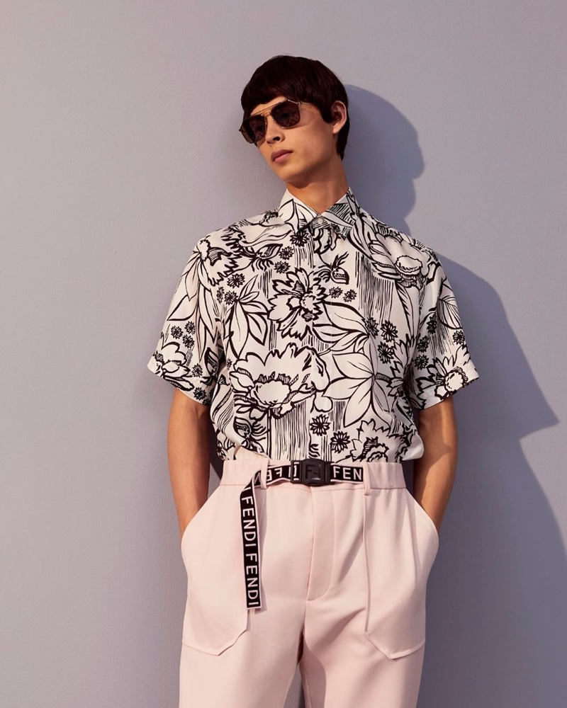 Yang Hao is a chic vision in a black and white print shirt with tailored trousers from Fendi's pre-fall 2020 collection.
