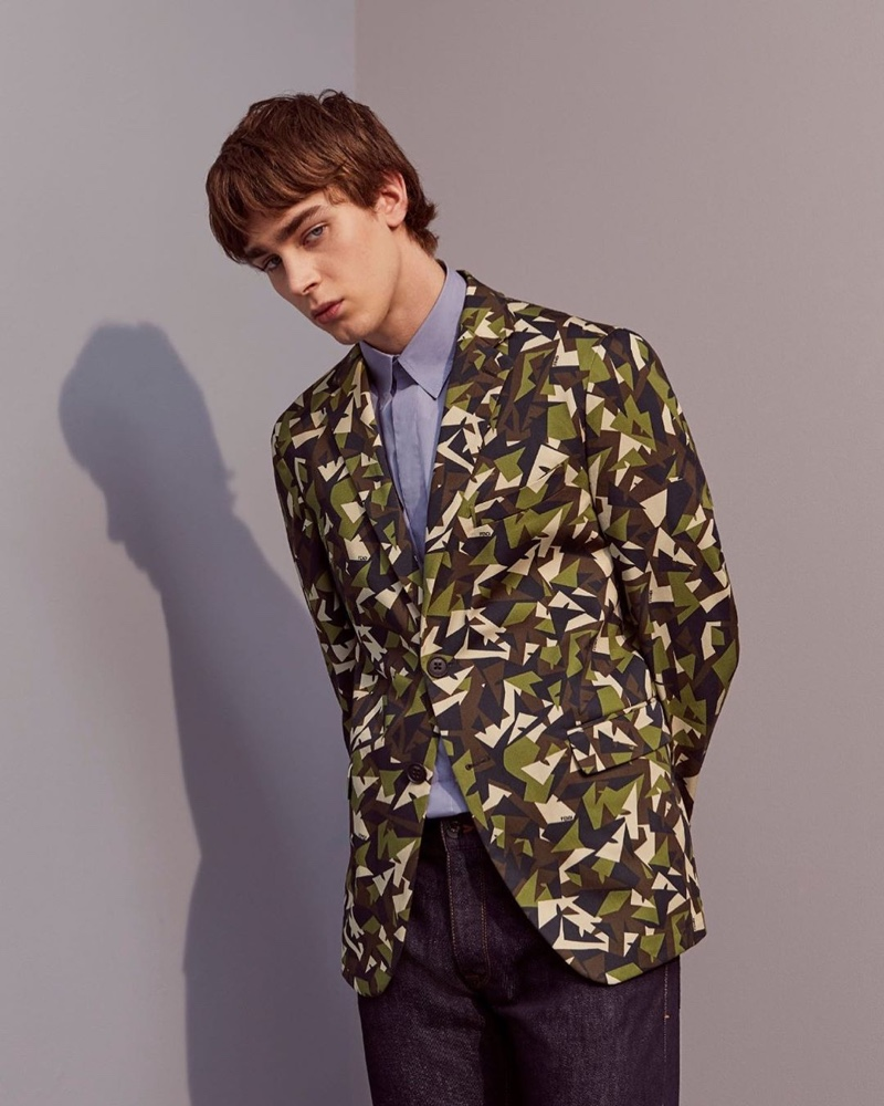 Mitchell Gorthy inspires in a modern camouflage print suit jacket from Fendi's pre-fall 2020 collection.
