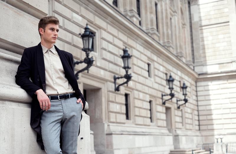 Linus wears coat Brachmann, shirt Hugo Boss, pants Selected Homme, and belt Gucci.