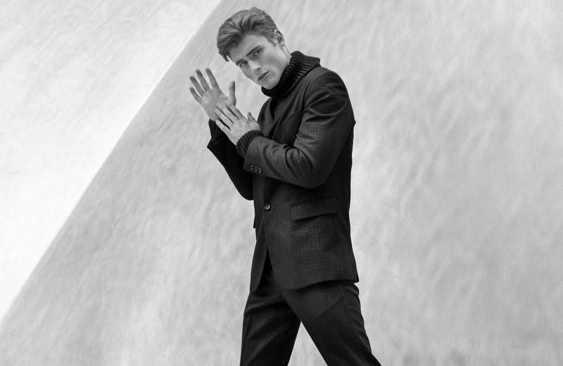 Linus wears suit Comme des Garçons, turtleneck Maison Margiela, and shoes Gucci.
