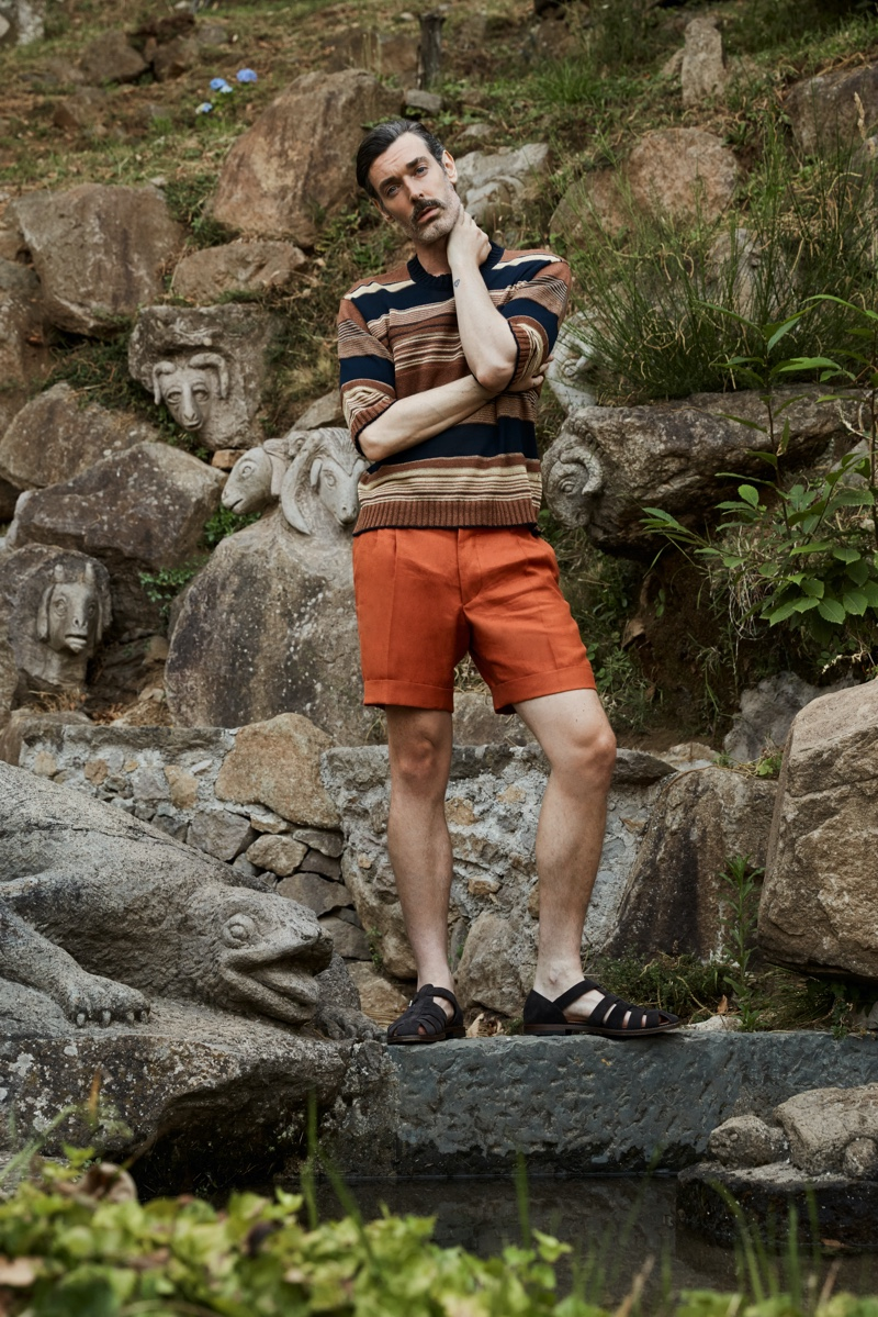 Dressing for an Italian holiday, Richard Biedul models a short-sleeve sweater with tailored shorts from Luca Larenza.