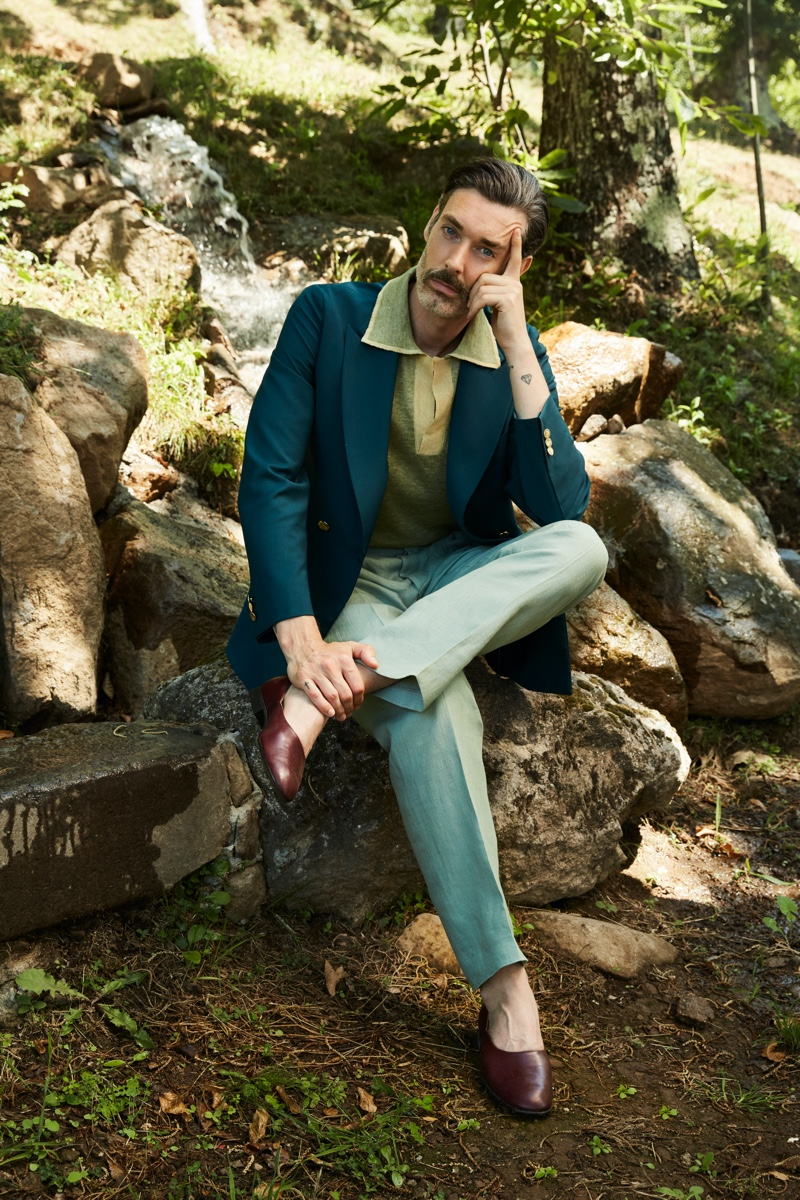 Front and center, Richard Biedul wears a tailored look from Luca Larenza's spring-summer 2021 collection.