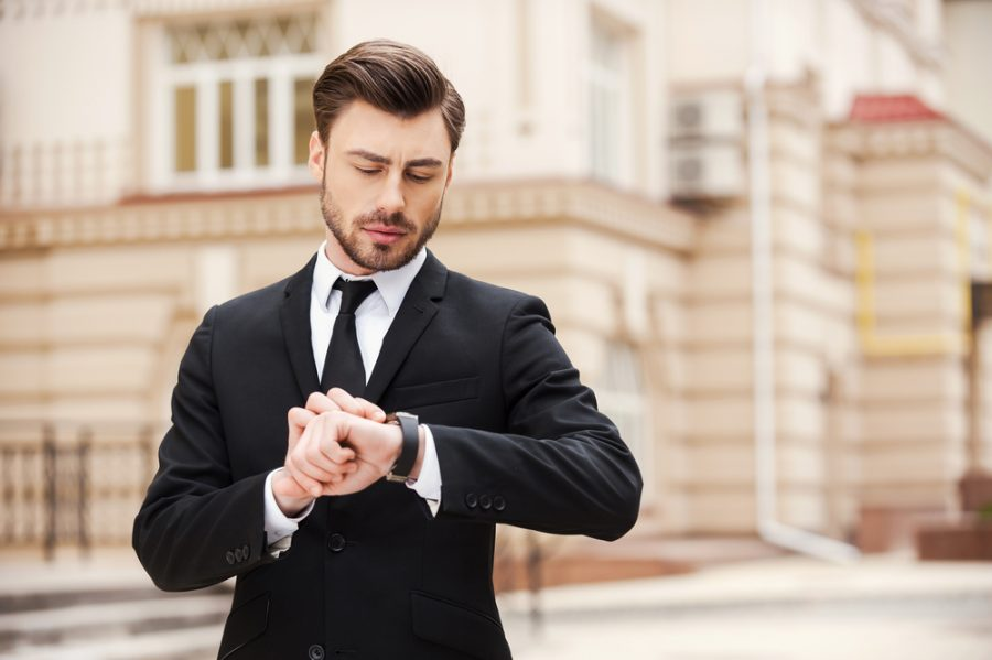 Man Wearing Suit and Watch