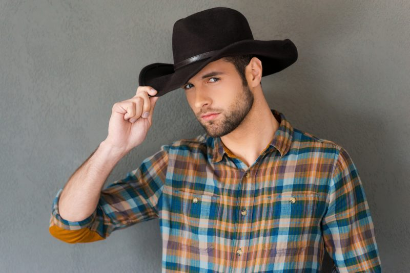 Man in Black Cowboy Hat with Plaid Shirt