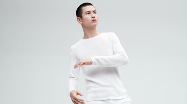 A summer vision, Kohei Takabatake sports a sweater and pants from Marc O'Polo's white capsule collection.