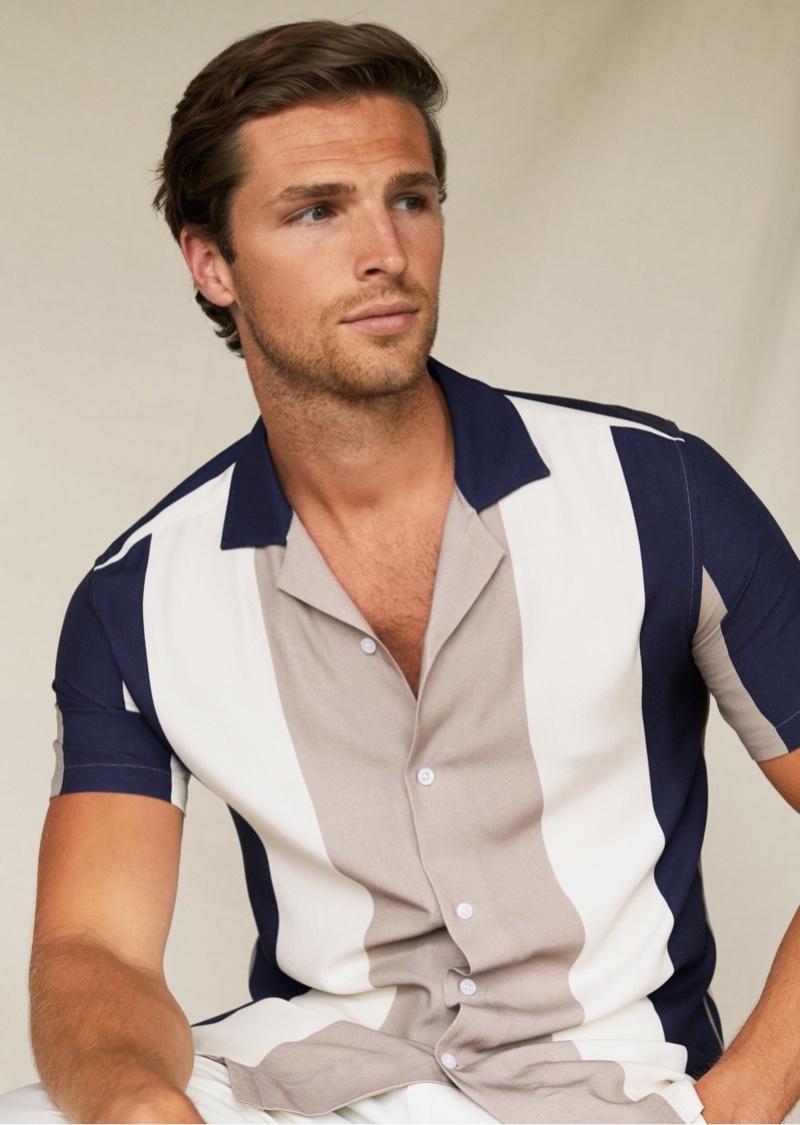 British model Edward Wilding wears a Cuban collar striped shirt from Reiss.
