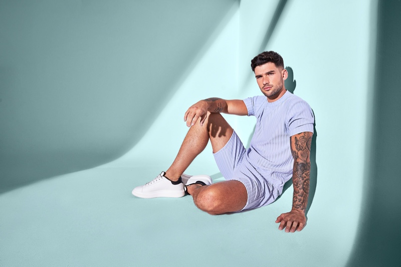 Hitting the studio, Brandan Stevens wears a lavender-colored coordinated look from River Island.