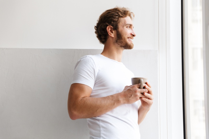 Smiling Man Holding Cup Tea