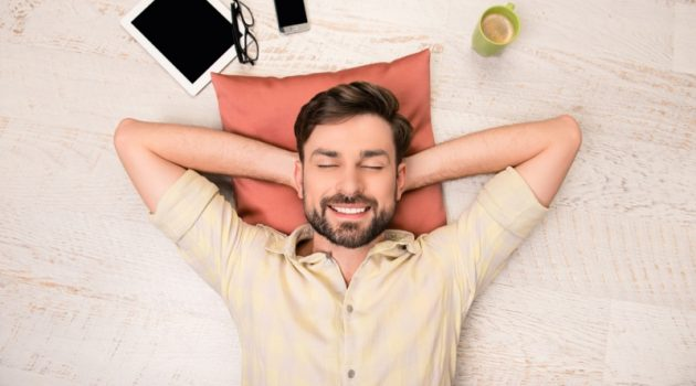 Smiling Man Relaxing Pillow Tablet Phone