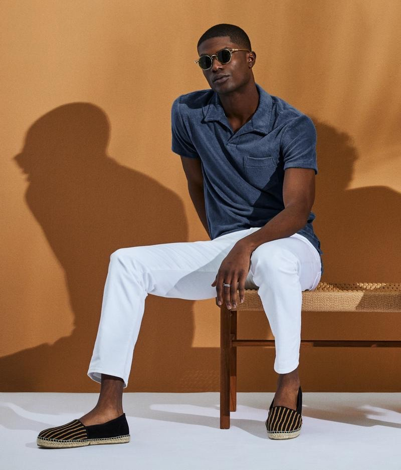 Making a case for adding a little texture to your wardrobe, Yahrock Bates models a terry Montauk polo in navy from Todd Snyder.