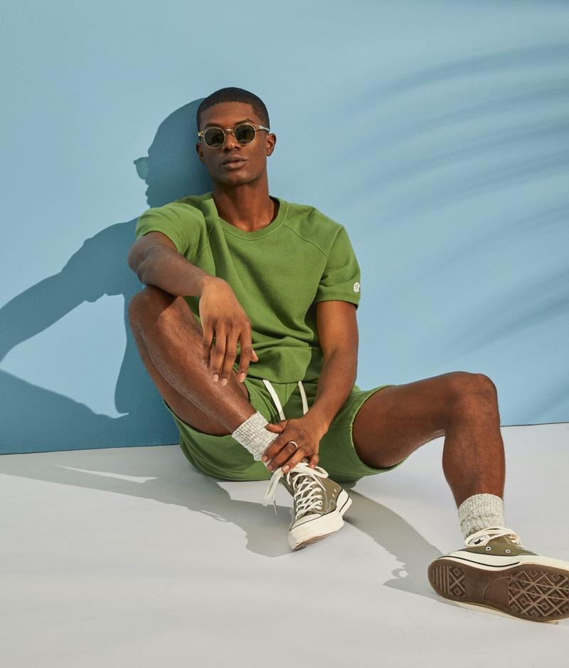 Sporty style takes the spotlight as Yahrock Bates wears a lightweight short-sleeve sweatshirt with warm up shorts from the Todd Snyder + Champion collection.