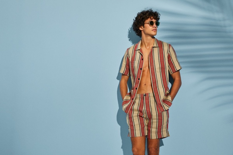 Francisco Henriques sports a red striped Bahama short-sleeve shirt with matching shorts from Todd Snyder.