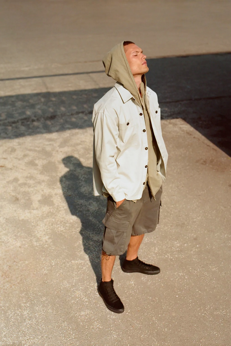 Making a stylish statement, William Los models a hooded shirt from Zara's summer collection.