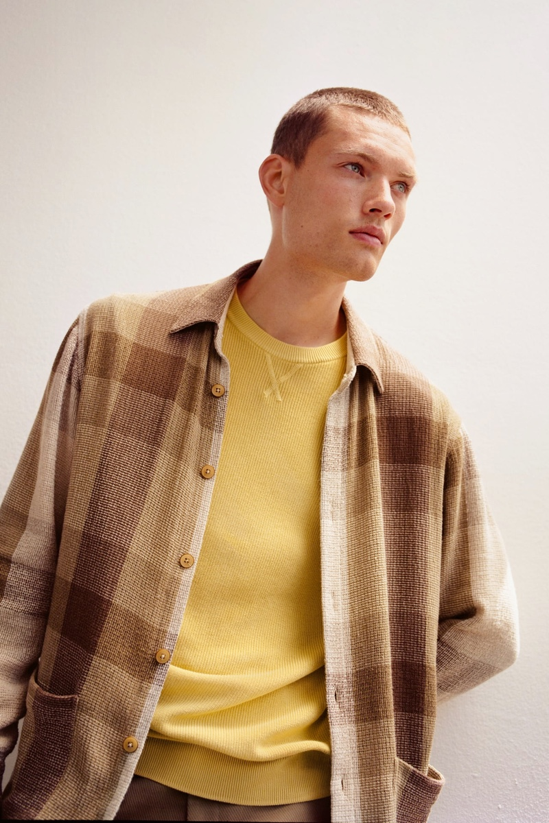Front and center, William Los dons a textured plaid overshirt from Zara.