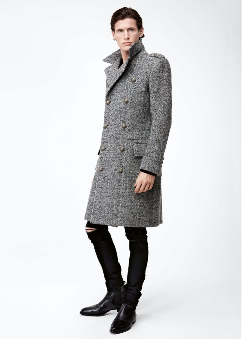 Emil dons a double-breasted herringbone coat from Balmain with Celine jeans for APROPOS Journal.
