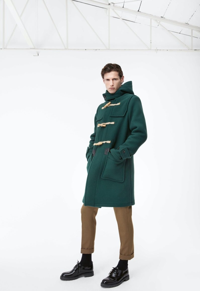 Making a statement in green, Emil dons a Caruso duffle coat and pants for APROPOS Journal.