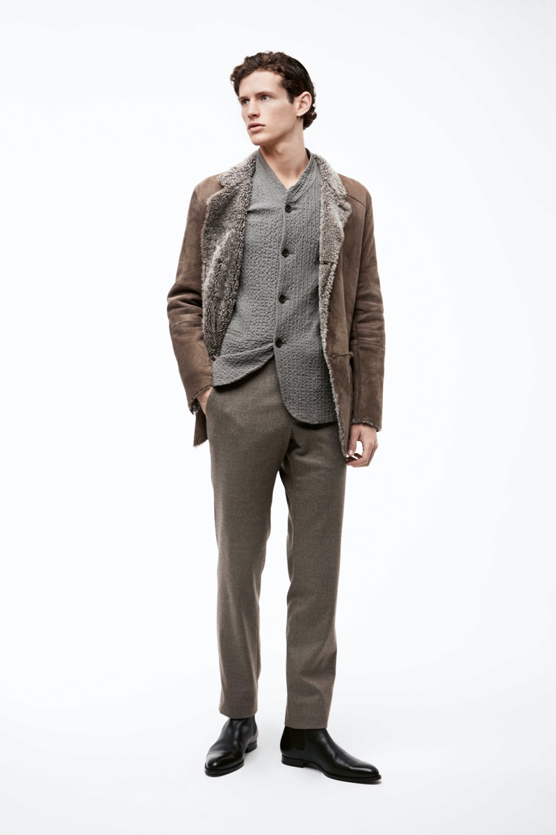 A chic vision, Emil models a jacket, blazer, and pants from Giorgio Armani for APROPOS Journal.