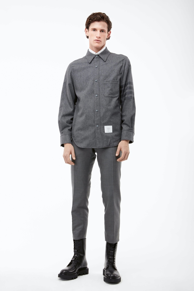 Connecting with APROPOS Journal for fall, Emil wears a gray look from Thom Browne.