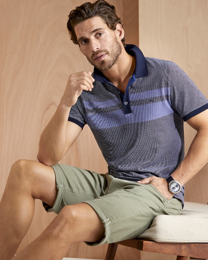 Embracing smart style, Simone Bredariol wears a polo and shorts from BRAX's summer 2020 collection.