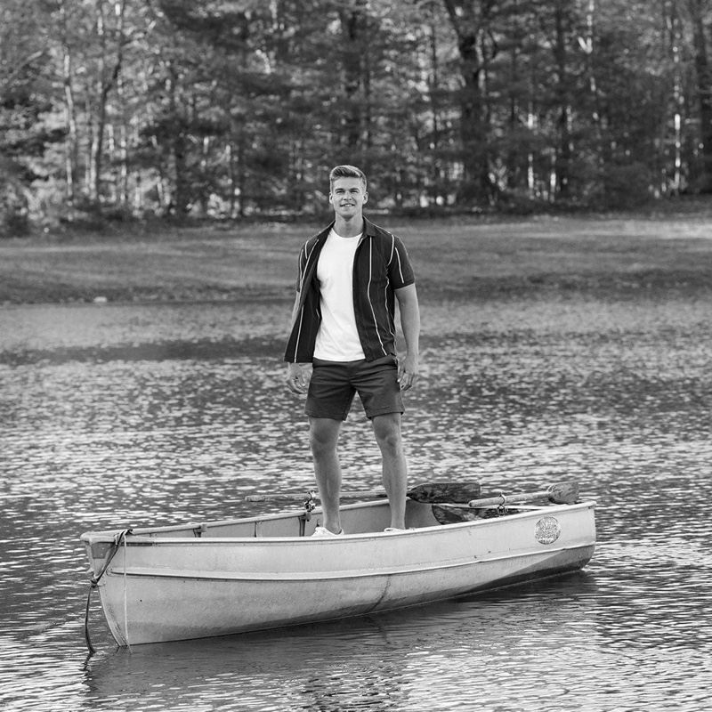Taking to a canoe, Mitchell Slaggert wears a short-sleeve Banana Republic shirt with a tee and shorts.