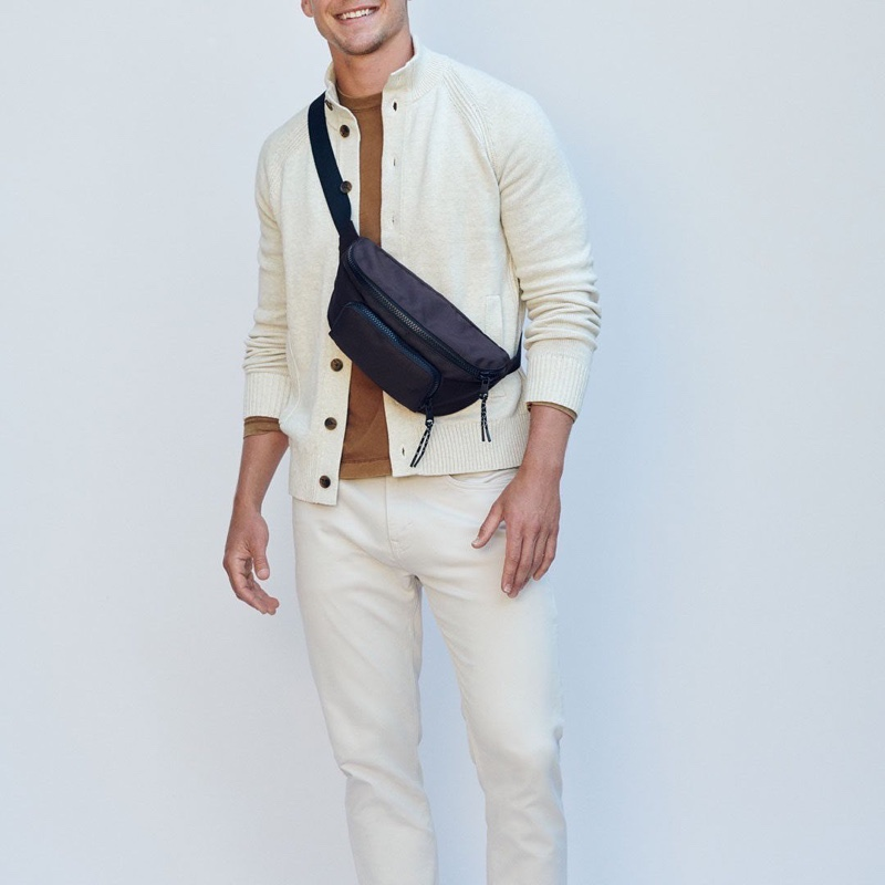 Model Mitchell Slaggert sports a cream-colored look from Banana Republic.