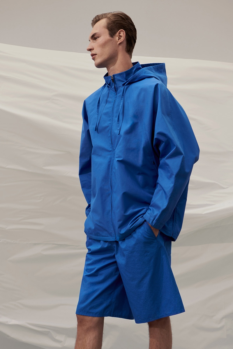 Kit Butler dons a vibrant blue look from COS 'To the Sea' collection.