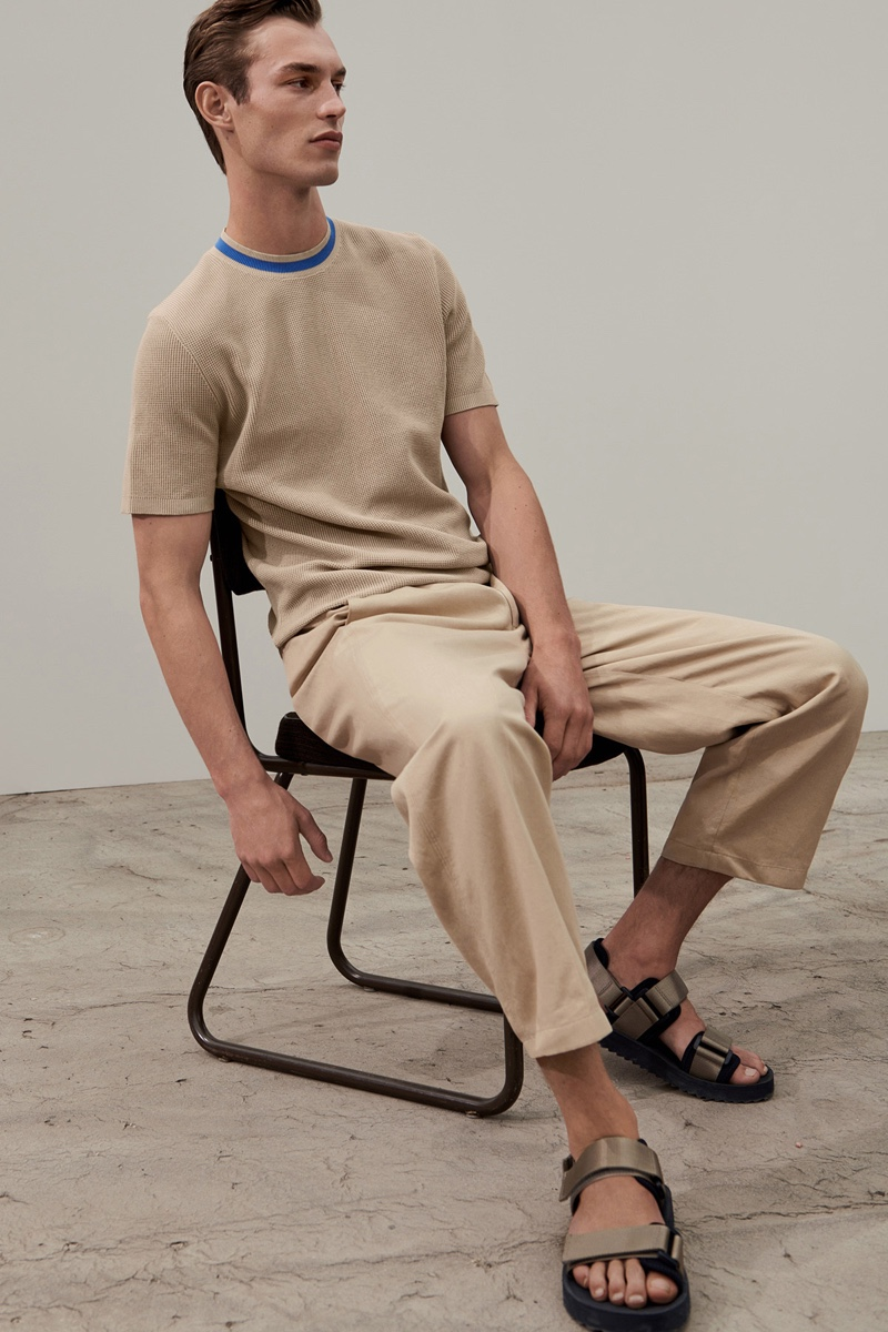 British model Kit Butler sports a neutral-colored outfit from COS.